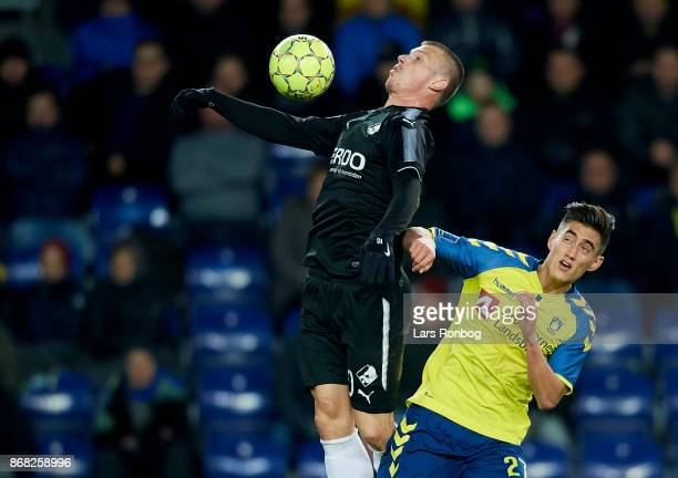 Marvin Pourie of Randers FC and Svenn Crone of Brondby IF compete for the ball during the Danish Alka Superliga match between Brondby IF and Randers...