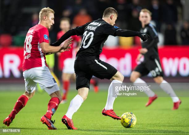 Marvin Pourie of Randers FC and Tobias Salquist of Silkeborg IF compete for the ball during the Danish Alka Superliga match between Silkeborg IF and...