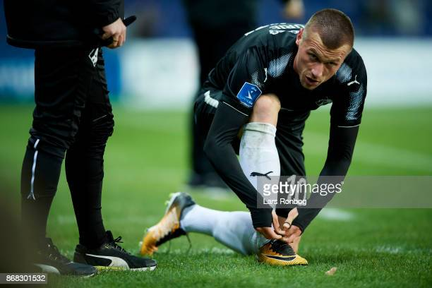 Marvin Pourie of Randers FC preparing his boots during the Danish Alka Superliga match between Brondby IF and Randers FC at Brondby Stadion on...