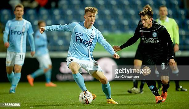 Marvin Pourie of Sonderjyske and Daniel A Pedersen of Silkeborg IF compete for the ball during the Danish Alka Superliga match between SonderjyskE...
