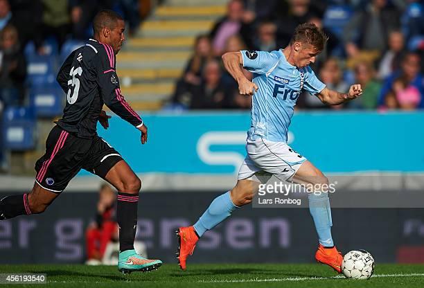 Marvin Pourie of Sonderjyske controls the ball in front of Mathias Zanka Jorgensen of FC Copenhagen during the Danish Superliga match between...