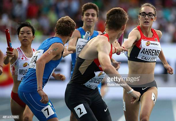 Marvin Schlegel prepares to take the baton from Lea Ahrens of Germany during the Mixed 4 x 400 Meters Relay against on day five of the IAAF World...