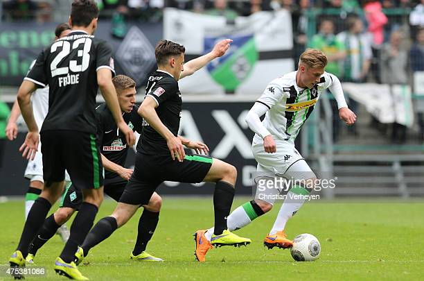 Marvin Schulz of Borussia Moenchengladbach is chased by Levent Aycicek and Maximilian Eggestein of Werder Bremen during the 3 Liga Playoffs match...