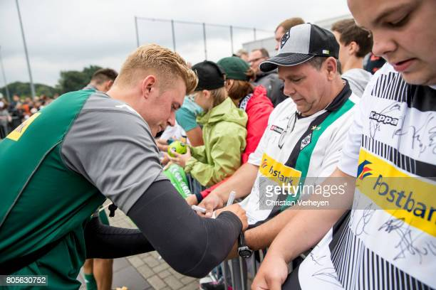 Marvin Schulz signs a fan shirt after a training session of Borussia Moenchengladbach at BorussiaPark on July 02 2017 in Moenchengladbach Germany