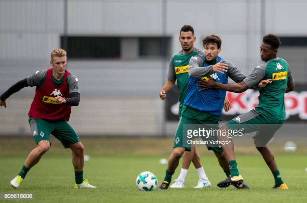 Marvin Schulz Timothee Kolodziejczak Tobias Strobl and Reece Oxford during a training session of Borussia Moenchengladbach at BorussiaPark on July 02...