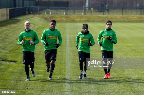 Marvin Schulz Tsiy William Ndenge Ibrahima Traore and Lars Stindl of Borussia Moenchengladbach run during a Training Session at BorussiaPark on March...