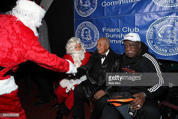 Marvin Scott David Dinkins and Cal Ramsey attend the Cloudy With A Chance of Meatballs 2 Holiday Screening hosted by The Friar's Club at Ziegfeld...