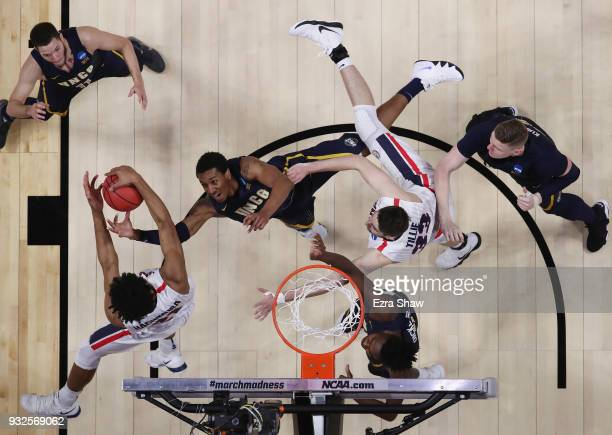 Marvin Smith of the UNCGreensboro Spartans battles for the ball with Rui Hachimura and Killian Tillie of the Gonzaga Bulldogs during the first round...