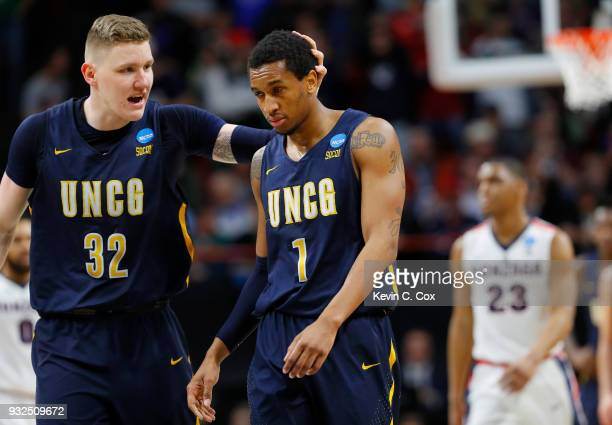 Marvin Smith of the UNCGreensboro Spartans reacts with Jordy Kuiper after missing a shot in the second half against the Gonzaga Bulldogs during the...