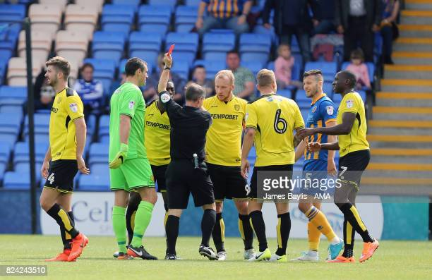 Marvin Sordell of Burton Albion is sent off by referee Rob Lewis following a challenge on Abu Ogogo of Shrewsbury Town during the Pre Season Friendly...