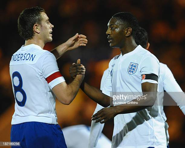 Marvin Sordell of England is congratulated on scoring the opening goal by Jordan Henderson during the UEFA Under-21 Championship Group 8 Qualifier...