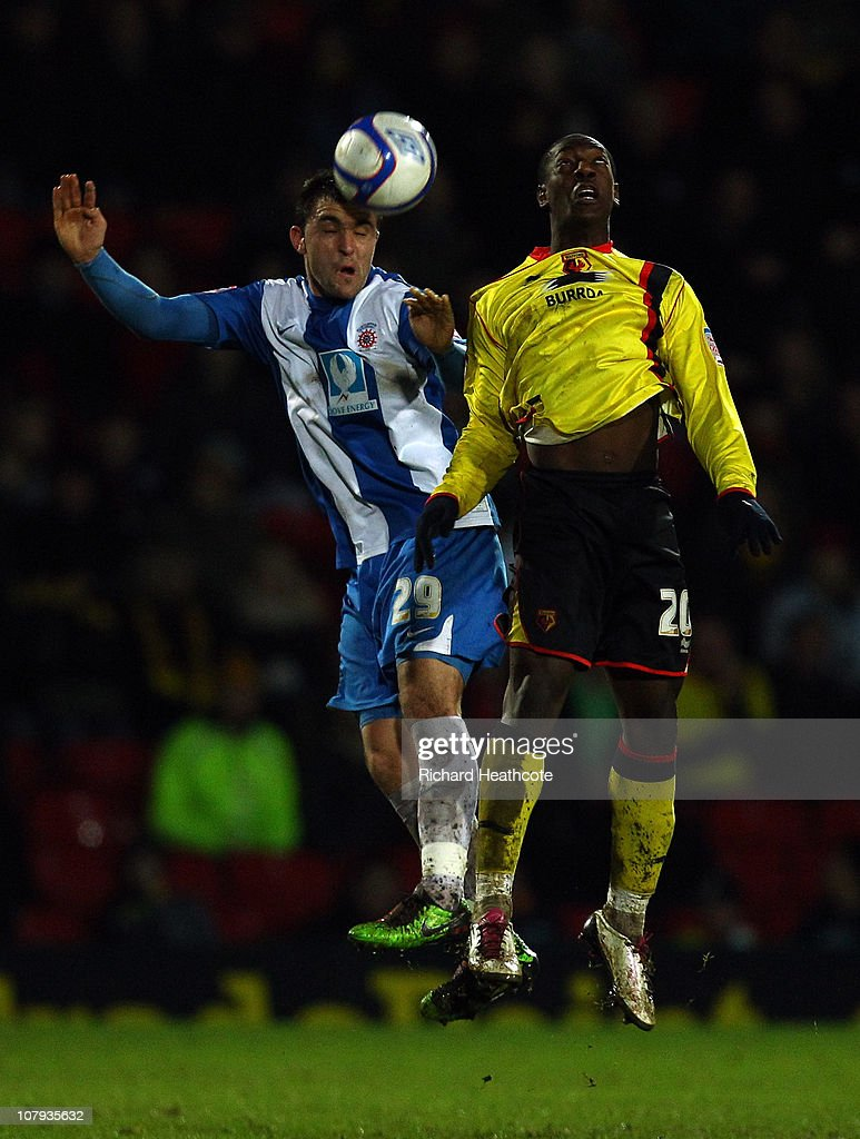 Marvin Sordell of Watford (r) goes up for a header with Peter Hartley of Hartlepool during the 3rd round FA Cup Sponsored by E.ON match between Watford and Hartlepool United at Vicarage Road on January 8, 2011 in Watford, England.