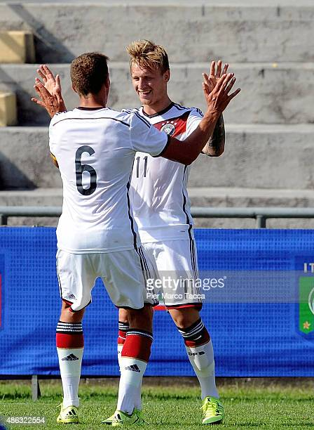 Marvin Stefaniak celebrates his first goal with his team player Grischa Pomel of Germany during the football match U20 Italy and U20 Germany...