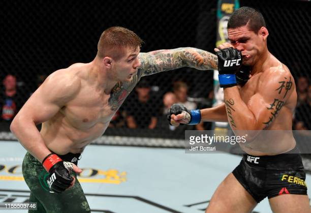 Marvin Vettori of Italy punches Cezar Ferreira of Brazil in their middleweight bout during the UFC Fight Night event at Golden 1 Center on July 13,...