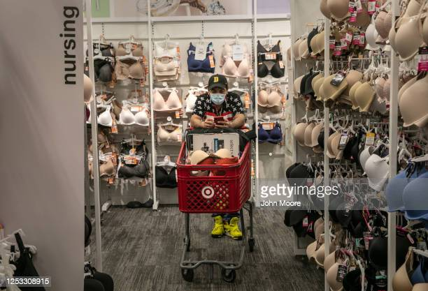 Marvin waits for his wife Zully to shop at Target on May 20 2020 in Stamford Connecticut The Guatemalan immigrants are adjusting to life after...