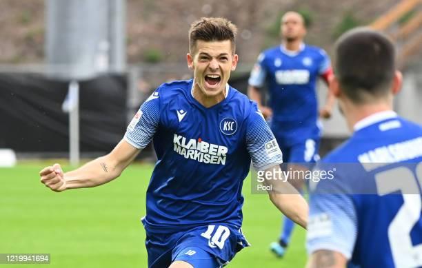 Marvin Wanitzek of Karlsruhe celebrates after scoring his teams first goal during the Second Bundesliga match between Karlsruher SC and VfB Stuttgart...