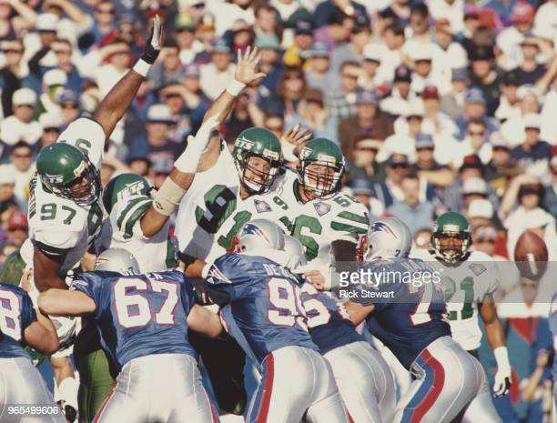 Marvin WashingtonPaul Frase and Jeff Lageman Defensive Linemen for the New York Jets jump to try to block a kick from Matt Bahr of the New England...