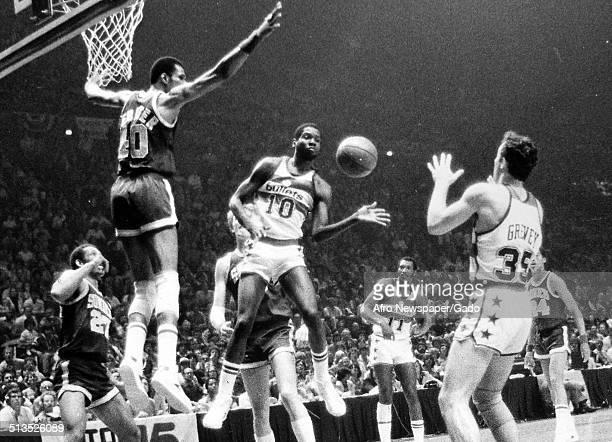 Marvin Webster, Bob Dandridge and Dennis Johnson during a basketball game, 1970.