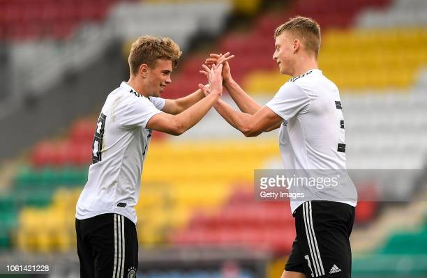Marvin Weiß of Germany celebrates after scoring his side's second goal with teammate Jannis Lang during the U17 International Friendly match between...