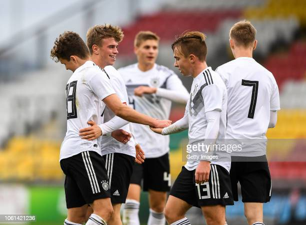 Marvin Weiß of Germany celebrates after scoring his side's second goal with teammate Lars Kehl during the U17 International Friendly match between...