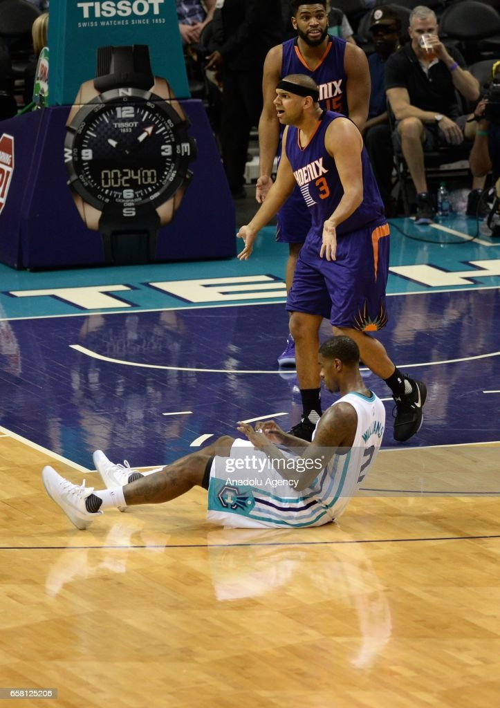 Marvin Williams of Charlotte Hornets on the floor after a fall during the NBA match between Phoenix Suns vs Charlotte Hornets at the Spectrum arena in Charlotte, NC, USA on March 26, 2017.
