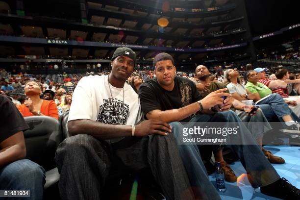 Marvin Williams of the Atlanta Hawks and Sean May of the Charlotte Bobcats watch the action between the Atlanta Dream and the Chicago Sky at Philips...