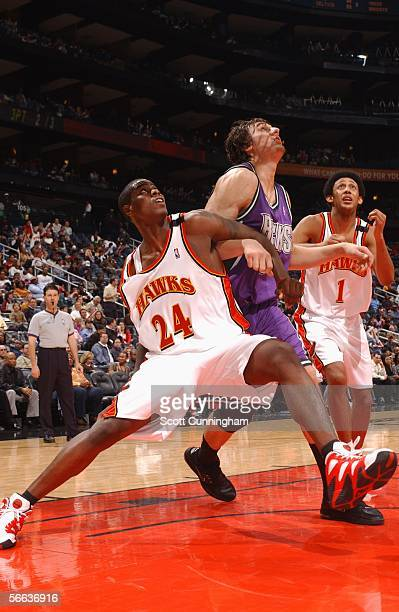 Marvin Williams of the Atlanta Hawks boxes out Andrew Bogut of the Milwaukee Bucks during the first meeting of the top 2 picks of last years NBA...