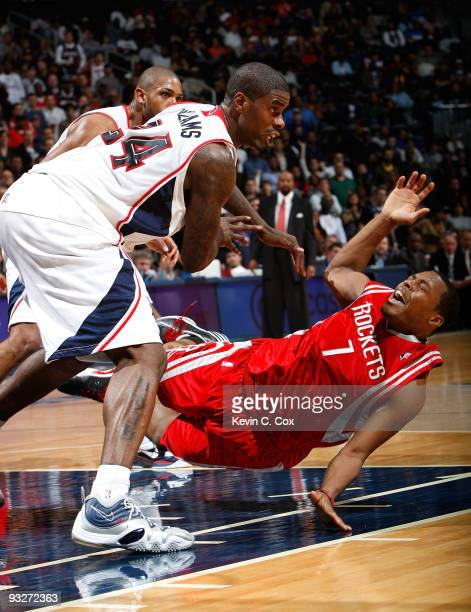 Marvin Williams of the Atlanta Hawks collides with Kyle Lowry of the Houston Rockets at Philips Arena on November 20 2009 in Atlanta Georgia NOTE TO...