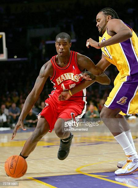 Marvin Williams of the Atlanta Hawks drives against Ronny Turiaf of the Los Angeles Lakers on December 8 2006 at Staples Center in Los Angeles...