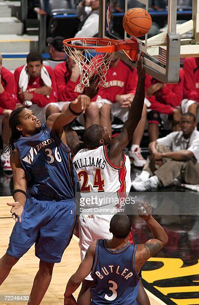 Marvin Williams of the Atlanta Hawks drives to the basket against Etan Thomas of the Washington Wizards at Philips Arena on October 23 2006 in...