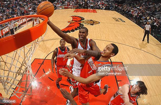 Marvin Williams of the Atlanta Hawks drives to the basket over Ryan Hollins of the Charlotte Bobcats at Philips Arena on January 19 2007 in Atlanta...