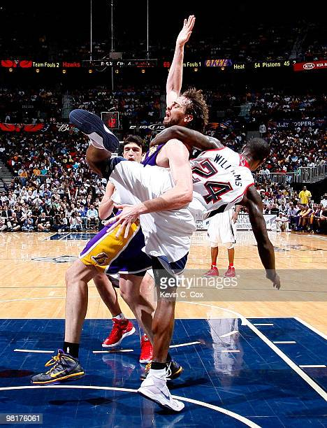 Marvin Williams of the Atlanta Hawks fouls Pau Gasol of the Los Angeles Lakers at Philips Arena on March 31 2010 in Atlanta Georgia NOTE TO USER User...