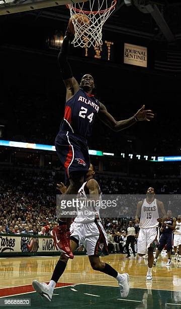 Marvin Williams of the Atlanta Hawks goes up for a dunk over Brandon Jennings of the Milwaukee Bucks in Game Four of the Eastern Conference...