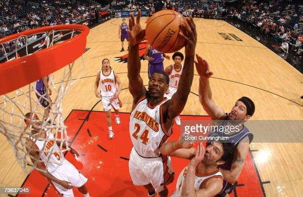 Marvin Williams of the Atlanta Hawks grabs a rebound against the Sacramento Kings at Philips Arena on March 19 2007 in Atlanta Georgia NOTE TO USER...