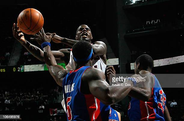 Marvin Williams of the Atlanta Hawks is fouled as he drives against Ben Wallace and DaJuan Summers of the Detroit Pistons at Philips Arena on...