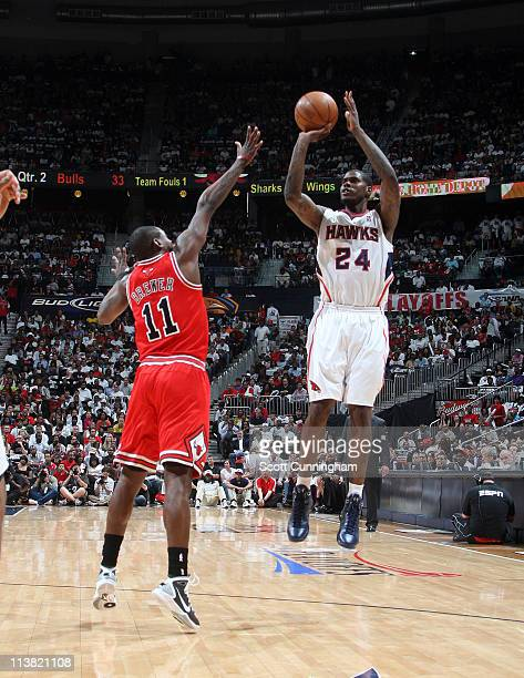 Marvin Williams of the Atlanta Hawks shoots against Ronnie Brewer of the Chicago Bulls in Game Three of the Eastern Conference Semifinals in the 2011...