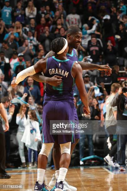 Marvin Williams of the Charlotte Hornets celebrates with Devonte' Graham during the game against the Chicago Bulls on October 23 2019 at Spectrum...