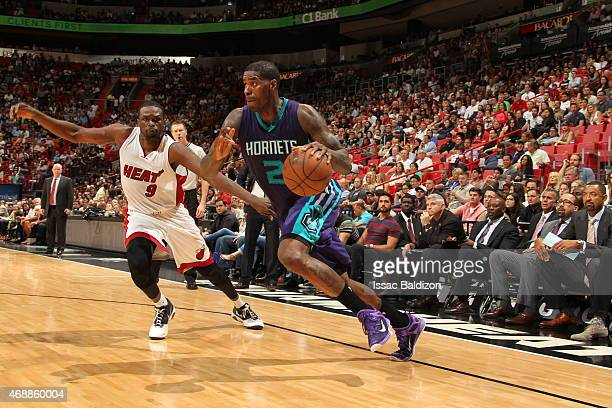 Marvin Williams of the Charlotte Hornets drives to the basket against Luol Deng of the Miami Heat on April 7 2015 at American Airlines Arena in Miami...