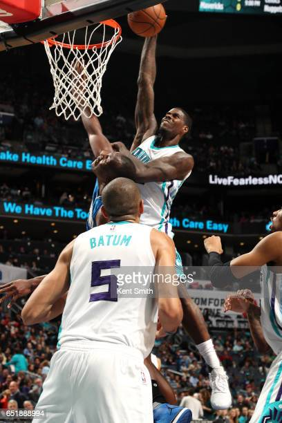 Marvin Williams of the Charlotte Hornets dunks the ball during the game against the Orlando Magic on March 10 2017 at Time Warner Cable Arena in...