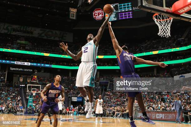 Marvin Williams of the Charlotte Hornets grabs the rebound against the Phoenix Suns on March 26 2017 at Spectrum Center in Charlotte North Carolina...