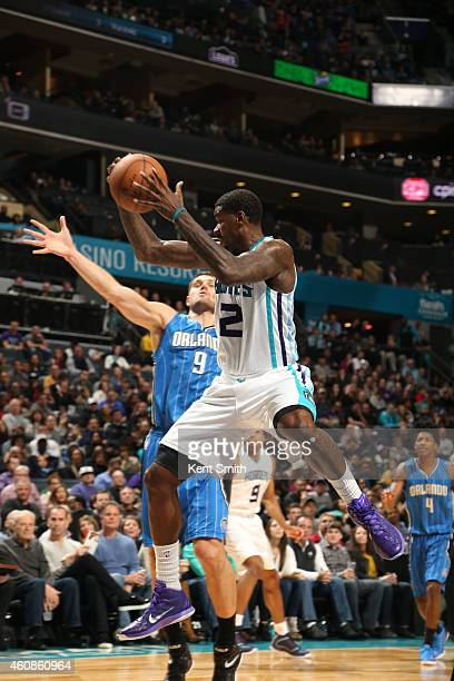 Marvin Williams of the Charlotte Hornets grabs the rebound during the game against the Orlando Magic at the Time Warner Cable Arena on December 27...