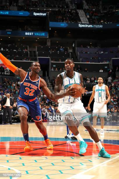 Marvin Williams of the Charlotte Hornets handles the ball against the New York Knicks on December 14 2018 at Spectrum Center in Charlotte North...