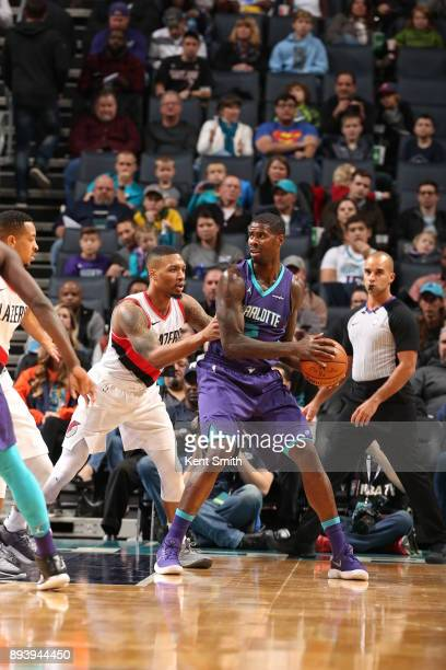 Marvin Williams of the Charlotte Hornets handles the ball against the Portland Trail Blazers on December 16 2017 at Spectrum Center in Charlotte...
