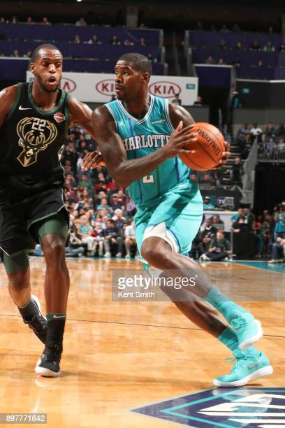 Marvin Williams of the Charlotte Hornets handles the ball against the Milwaukee Bucks on December 23 2017 at the Spectrum Center in Charlotte North...