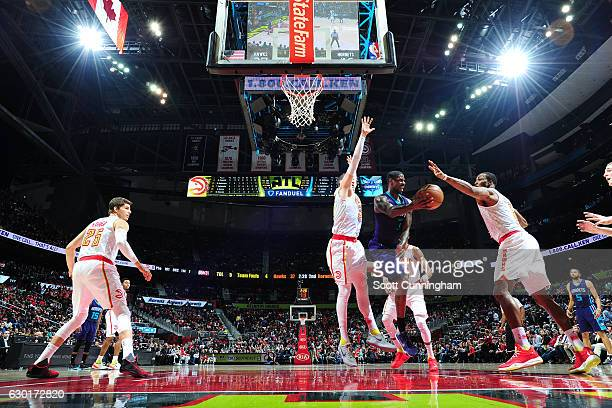 Marvin Williams of the Charlotte Hornets passes the ball during the game against the Atlanta Hawks on December 17 2016 at Philips Arena in Atlanta...