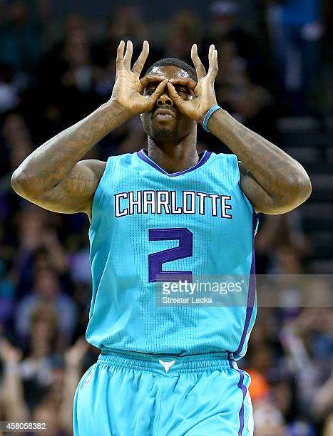 Marvin Williams of the Charlotte Hornets reacts after making a basket against the Milwaukee Bucks during their game at Time Warner Cable Arena on...