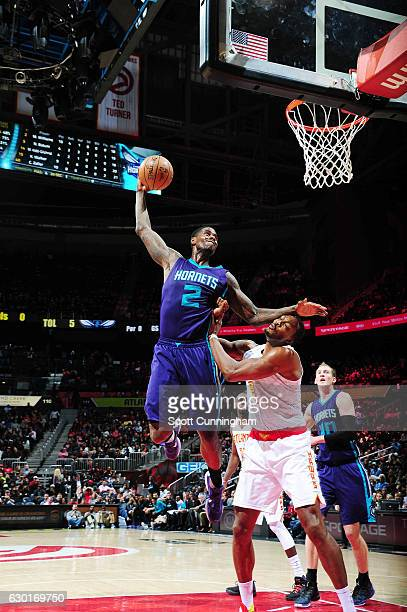 Marvin Williams of the Charlotte Hornets shoots the ball against Dwight Howard of the Atlanta Hawks during the game on December 17 2016 at Philips...