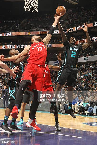 Marvin Williams of the Charlotte Hornets shoots the ball against Jonas Valanciunas of the Toronto Raptors during the game on January 20 2017 at...