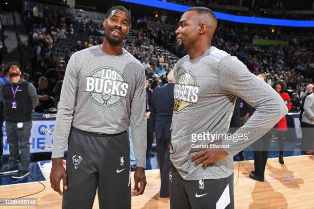 Marvin Williams of the Milwaukee Bucks and Paul Millsap of the Denver Nuggets talk before the game on March 09 2020 at the Pepsi Center in Denver...