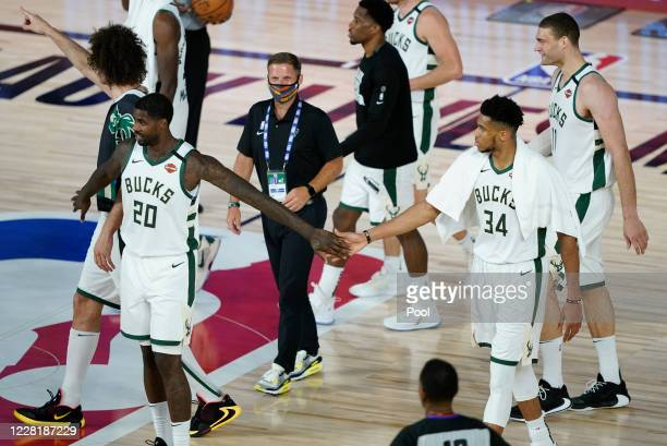 Marvin Williams of the Milwaukee Bucks celebrates with teammate Giannis Antetokounmpo after an NBA basketball first round playoff game against the...